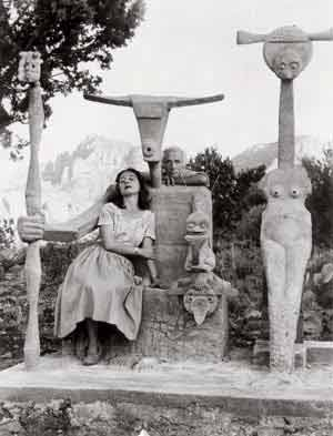 Dorothea Tanning and Max Ernst with his sculpture, Capricorn